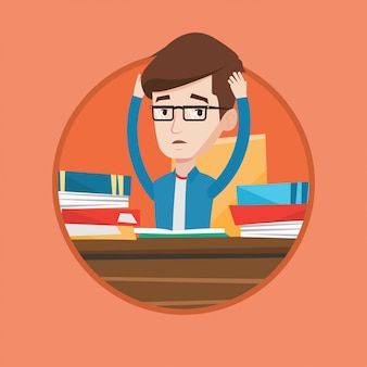 Student siedzi przy stole z stosami książek.