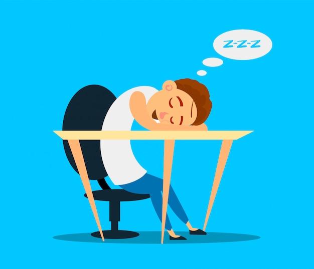 Student śpi przy biurku w klasie.