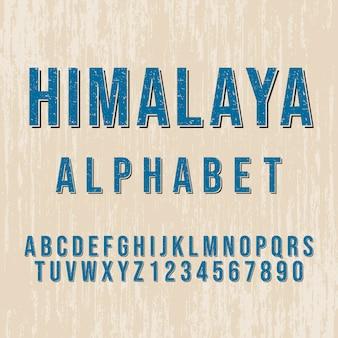 Styl alfabetu himalajskiego. nowoczesna czcionka dekoracyjna. zestaw liter i cyfr.