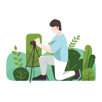 Styl fotografa przy pracy ze statywem w dzikim miejscu