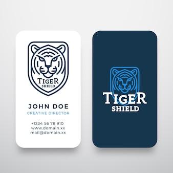 Styl linii tygrys twarz tarcza streszczenie wektor logo i szablon wizytówki dzikie zwierzę głowa sillho...