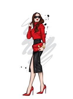 Stylowa dziewczyna w modne ubrania i buty.