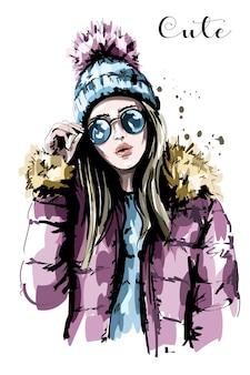 Stylowa kobieta w zimowe ubrania