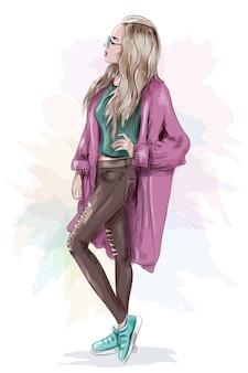 Stylowa piękna dziewczyna w dżinsach, crop topie i trampkach.