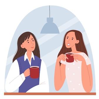 Stylowe dziewczyny siedzące w kawiarni i rozmawiające o kobietach sukcesu