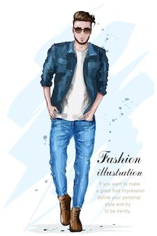 Stylowy przystojny mężczyzna w modnych ubraniach