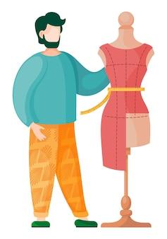 Sukienka na manekinie z miarką i brodaty mężczyzna
