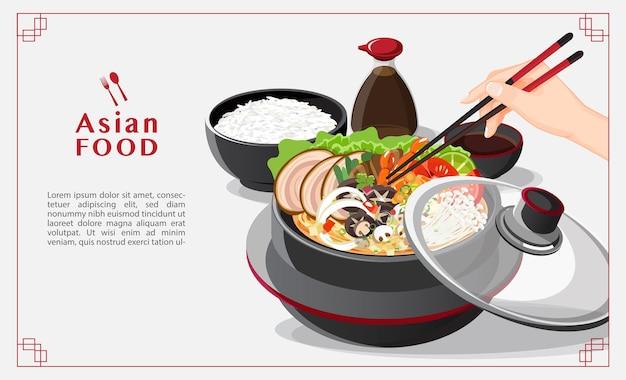 Sukiyaki w gorącym garnku w restauracji, ręka trzymająca pałeczki jedząca shabu