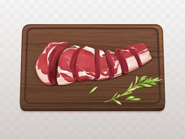 Surowy filet z marmurkowego mięsa pokrojony na kawałki lub porcje, aby ugotować stek lub grill z przyprawami na desce do krojenia