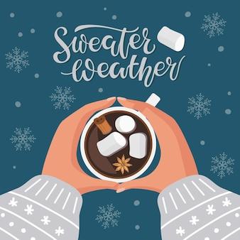 Sweter pogoda kaligrafia napis i filiżanka gorącej czekolady lub kawy z cynamonem prawoślazu