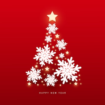 Świąt i szczęśliwego nowego roku z kryształowymi płatkami śniegu choinka z błyszczącymi światłami