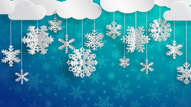 Świąteczna ilustracja z białymi chmurami i trójwymiarowymi papierowymi płatkami śniegu wiszącymi na jasnoniebieskim tle