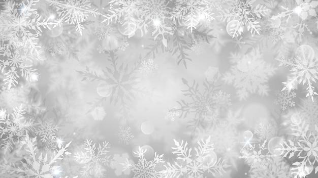 Świąteczna ilustracja z białymi niewyraźnymi płatkami śniegu, blaskiem i iskierkami na szarym tle