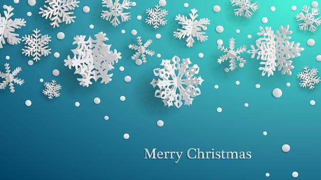 Świąteczna ilustracja z białymi trójwymiarowymi papierowymi płatkami śniegu na jasnoniebieskim tle