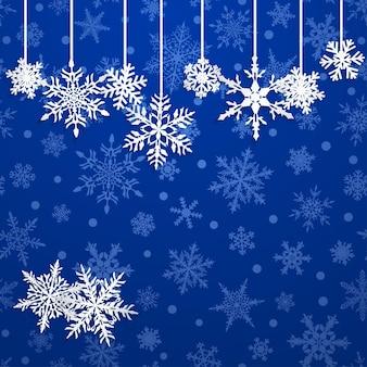 Świąteczna ilustracja z białymi wiszącymi płatkami śniegu na niebieskim tle