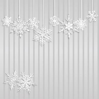 Świąteczna ilustracja z białymi wiszącymi płatkami śniegu na szarym tle w paski