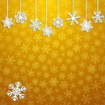 Świąteczna ilustracja z białymi wiszącymi płatkami śniegu na żółtym tle