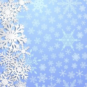 Świąteczna ilustracja z dużymi białymi płatkami śniegu z cieniami na jasnoniebieskim tle