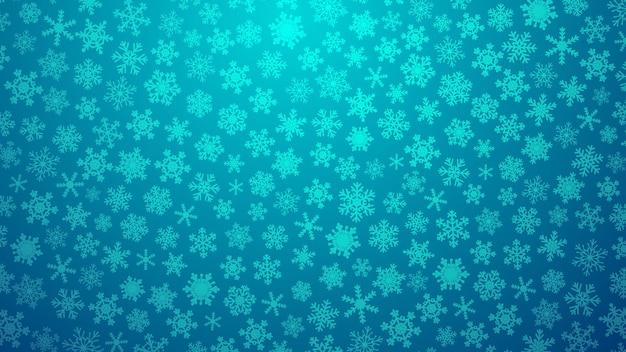 Świąteczna ilustracja z różnymi małymi płatkami śniegu na gradientowym tle w jasnoniebieskich kolorach