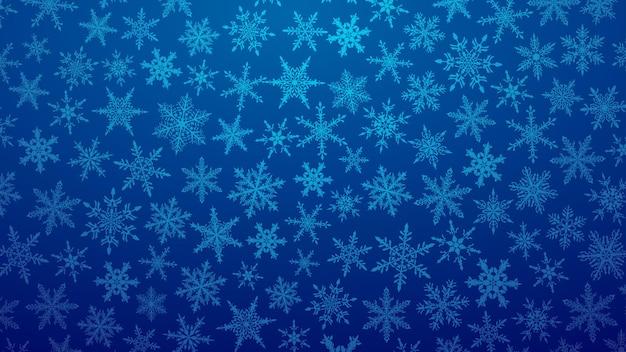 Świąteczna ilustracja z różnymi małymi płatkami śniegu na gradientowym tle w niebieskich kolorach