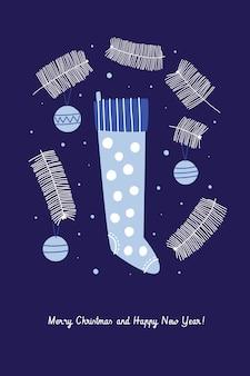 Świąteczna kartka świąteczna. gałęzie jodły, bombki i niebieska skarpeta na prezenty.