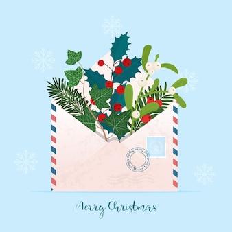 Świąteczna koperta z różnymi roślinami bożonarodzeniowymi jemioła ostrokrzew jagodowy bluszcz sosnowy cis