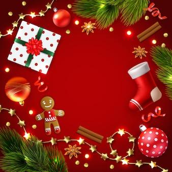 Świąteczna ramka otoczona akcesoriami ozdoby światła i prezenty