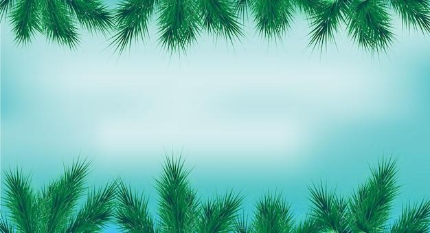 Świąteczna ramka z gałęziami jodły w górę iw dół na niebieskim tle