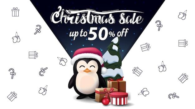 Świąteczna wyprzedaż, do 50 zniżki, z pingwinem w czapce świętego mikołaja z prezentami, kosmiczna wyobraźnia