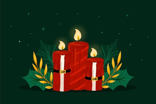 Świąteczne dekoracje ze świecą i kostium świętego mikołaja