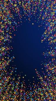 Świąteczne godne konfetti. gwiazdy uroczystości. radosne konfetti na ciemnym niebieskim tle. fascynujący świąteczny szablon nakładki. pionowe tło wektor.