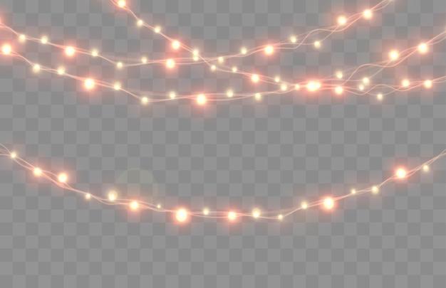 Świąteczne lampki na przezroczystym tle jasny bożonarodzeniowy wianek wektor świecące żarówki na drutach zestaw świątecznych świateł