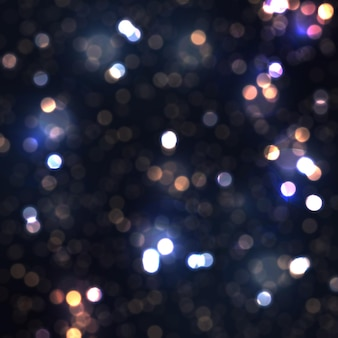 Świąteczne niebieskie świecące tło z kolorowymi światłami bokeh odbija latające świecące cząstki pyłu