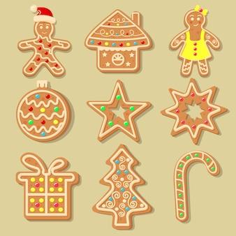 Świąteczne pierniczki w kształcie bombki, choinki, cukierka, gwiazdki, domku, płatka śniegu, prezentu i piernikowych ludzików. słodkie domowe ciasteczka glazurowane.