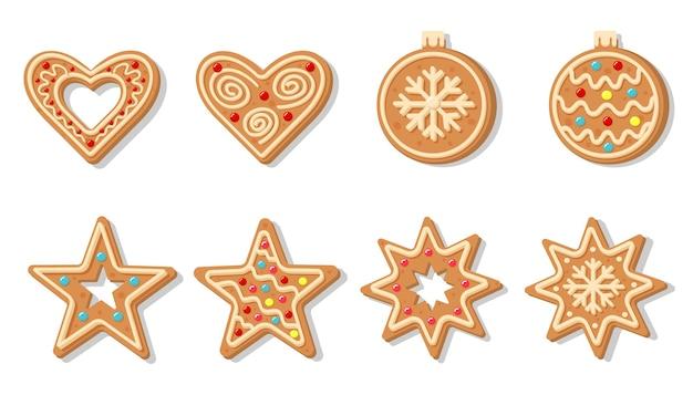 Świąteczne pierniczki w kształcie bombki, płatka śniegu, gwiazdki i serca. słodkie domowe ciasteczka glazurowane.