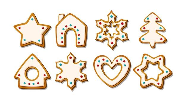 Świąteczne pierniczki zimowe glazurowane herbatniki w kształcie domku z piernika i drzewa vector