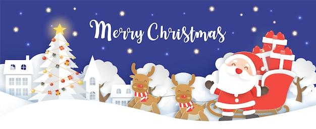 Świąteczny baner z mikołajem i reniferem w śnieżnej wiosce wycięty z papieru i styl rękodzieła.