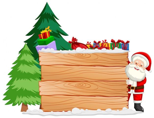 Świąteczny motyw z mikołajem i drewnianą deską
