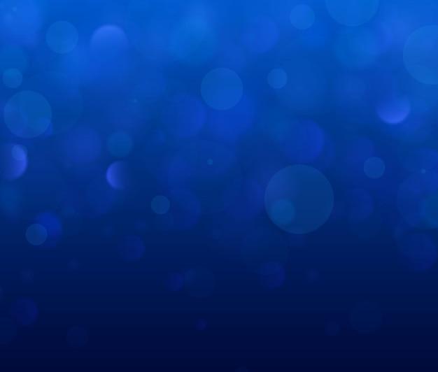Świąteczny niebieski i biały świecące tło z bokeh kolorowe światła.