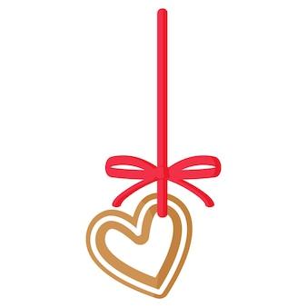 Świąteczny piernikowy ciasteczko w kształcie serca pokryte białym lukrem z czerwoną wstążką. wesołych świąt i szczęśliwego nowego roku koncepcja.
