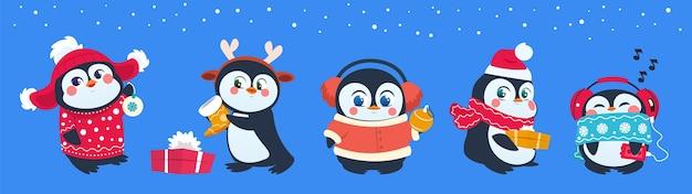 Świąteczny pingwin. śmieszne zwierzęta śnieżne, słodkie pingwiny dla dzieci postaci z kreskówek w czapce zimowej z pudełkiem i piłkami.