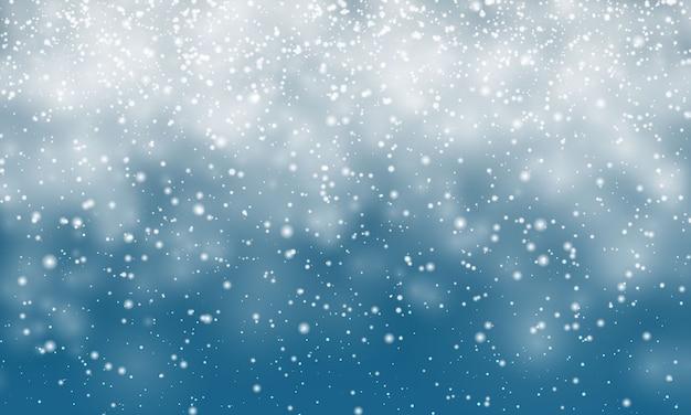 Świąteczny śnieg. spadające płatki śniegu na niebieskim tle. opad śniegu.