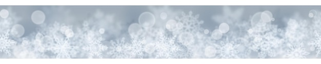 Świąteczny sztandar rozmytych płatków śniegu na szarym tle