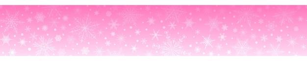 Świąteczny sztandar z różnymi płatkami śniegu, w różowych kolorach