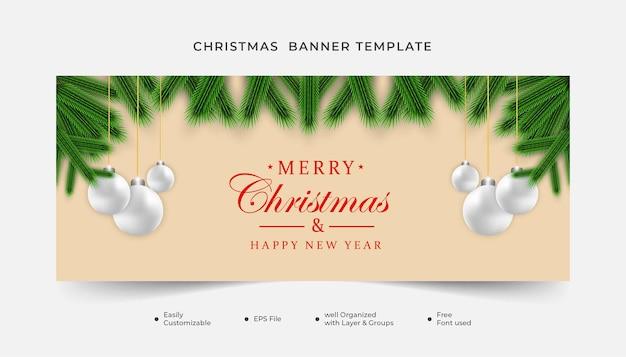 Świąteczny sztandar zielony liść z bożonarodzeniowym elementem i bożonarodzeniową piłką