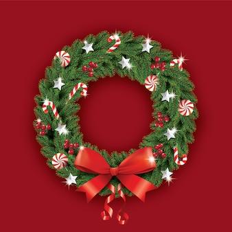 Świąteczny wieniec z czerwoną kokardą i wstążką zdobiony wieniec z sosnowych gałęzi realistyczny wygląd