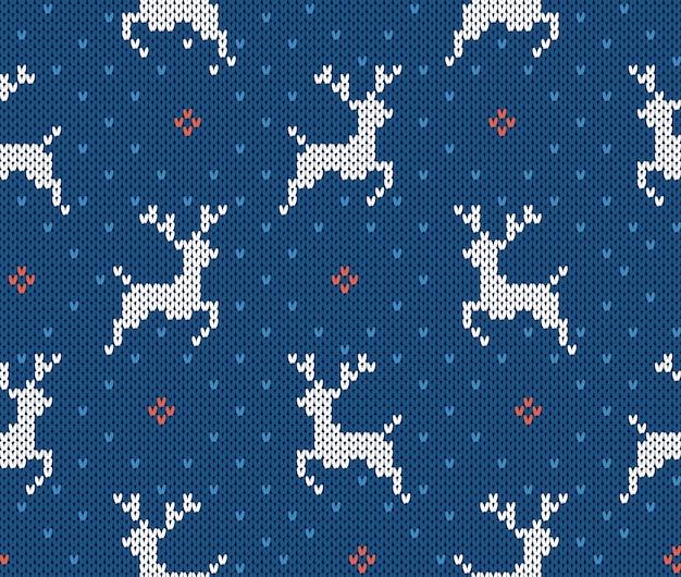 Świąteczny wzór na drutach z jeleniami. boże narodzenie bezszwowe tło. tekstura swetra z dzianiny. wakacyjny nadruk.