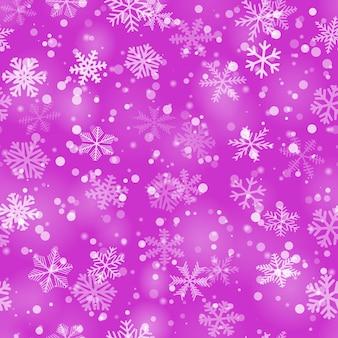 Świąteczny wzór płatków śniegu o różnych kształtach, rozmiarach i przezroczystości w fioletowych kolorach
