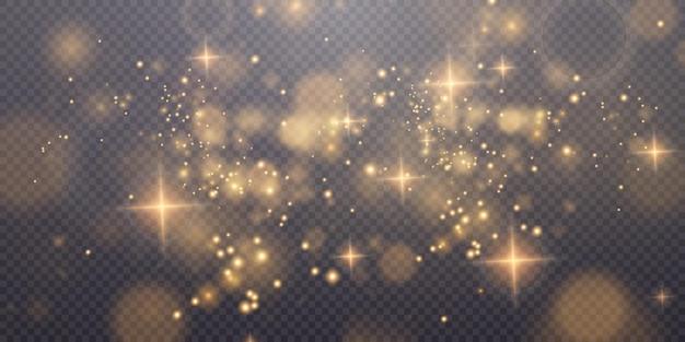 Świąteczny złoty błyszczący pył z jasnozłotymi błyszczącymi gwiazdami świąteczna błyszcząca tekstura