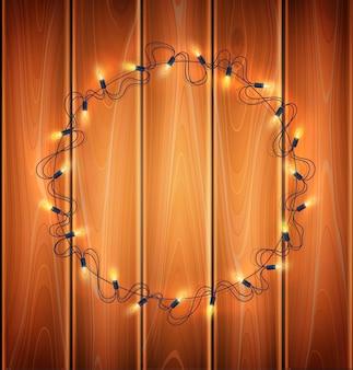 Światła bożego narodzenia, realistyczne girlanda na tle drewna